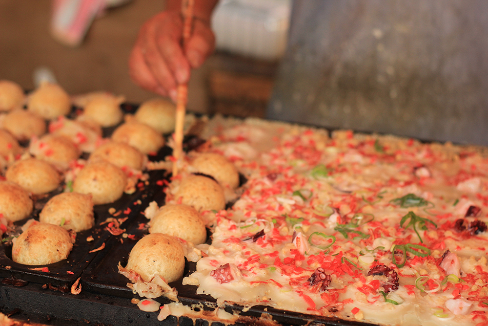 making takoyaki in omatsuri