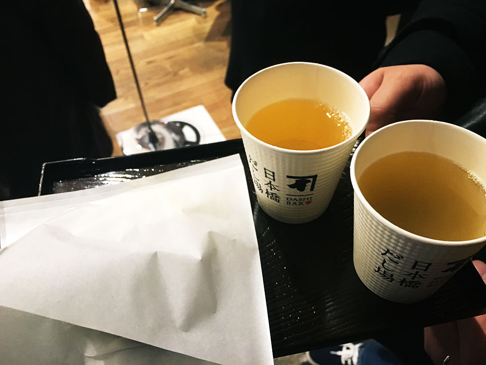 Cups of dashi soup and pork bun. The soup was very delicate.