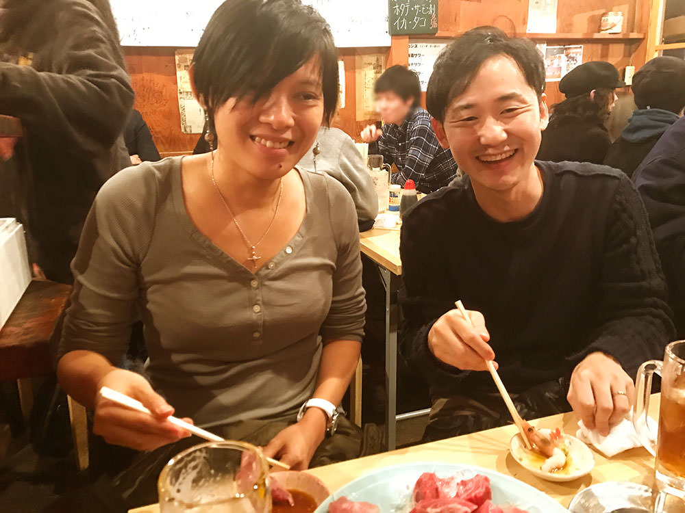 Agnes and Yuji enjoying sashimi
