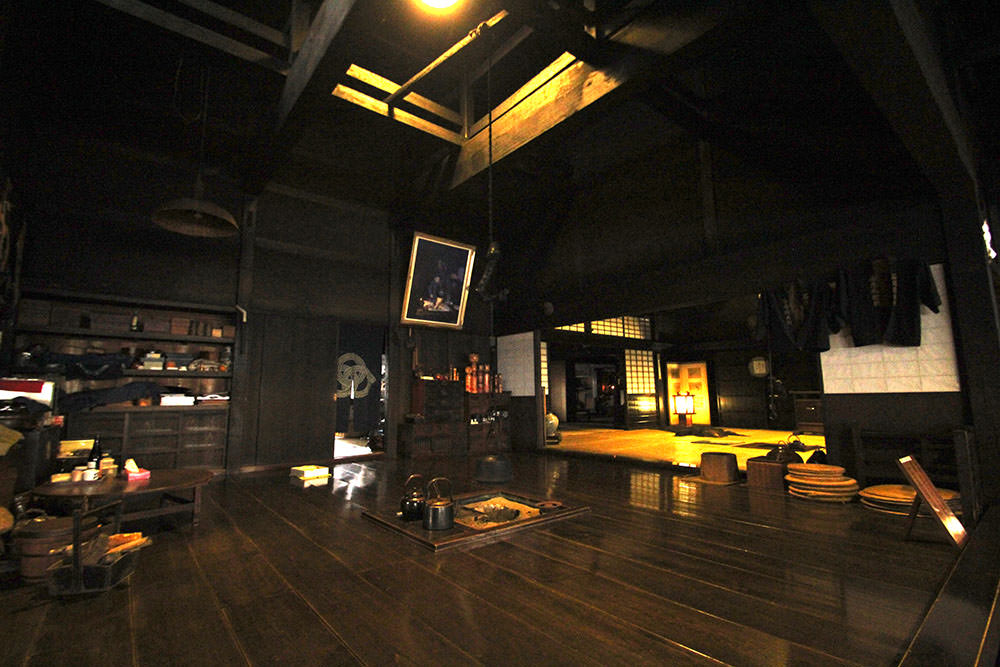 Inside of the house where you can enter with the entrance fee 100 yen. On the left is the living room and on the right is a well and kitchen.