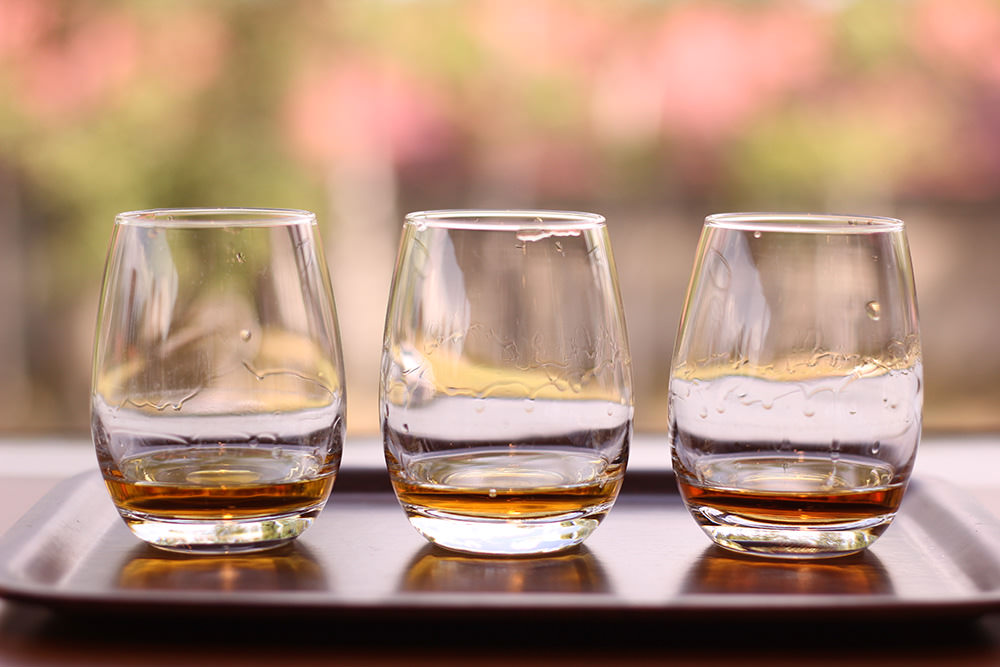 From the left: Pure Malt Whisky Taketsuru, Blended Whisky Super Nikka, and Apple Wine.