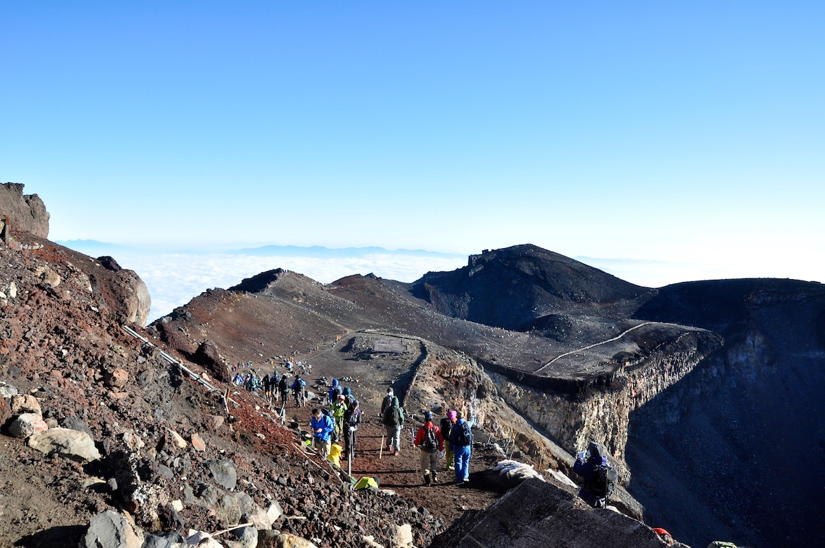 Many people challenge to hike Mt. Fuji